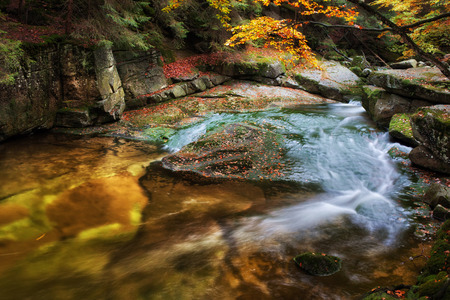 czech: Small creek in rocky scenery of the mountain forest
