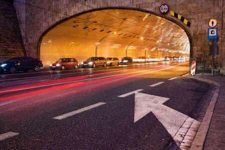 Night traffic, street tunnel at Solidarity Avenue (Polish: Aleja Solidarnosci) in city of Warsaw, Poland