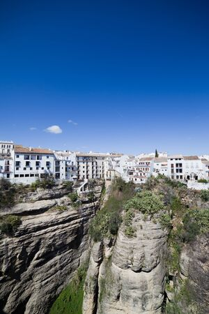 blanco: City of Ronda, Pueblo Blanco, white houses on high cliff of El Tajo gorge in Andalusia, Spain