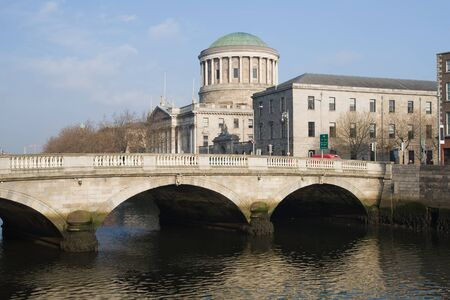 liffey: City of Dublin in Ireland, ODonovan Rossa Bridge on River Liffey, Four Courts in the background