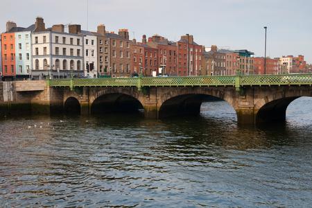 tenement buildings: City of Dublin skyline in Ireland, Grattan Bridge on River Liffey, cityscape
