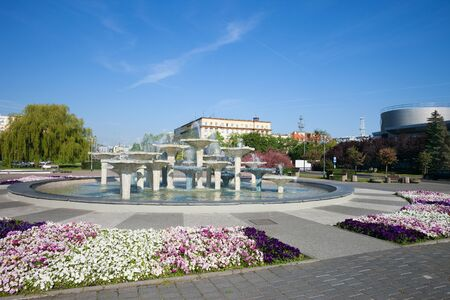 city park fountain: Kosciuszko Square in city of Gdynia, Poland, public park with flower garden and fountain