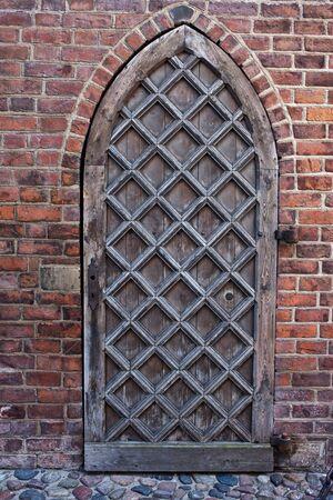 wood door: Gothic wooden door to St. Marys Church in Gdansk, Poland