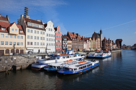 tour boats: City of Gdansk Old Town waterfront at Motlawa River in Poland, tour boats, passenger ferry Editorial