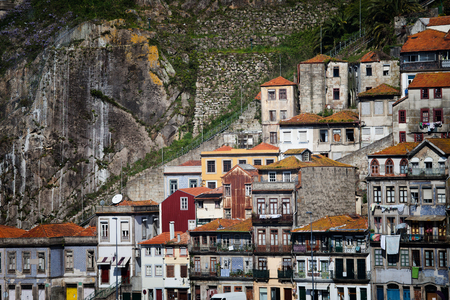 neighbourhood: Picturesque city of Porto in Portugal, Europe, traditional Portuguese houses on steep cliff along Funicular dos Guindais