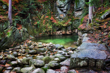 sudetes: Small creek pool at rocky cliifside in the autumn mountains wilderness, Sudetes, Poland