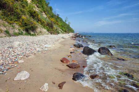 pebbles: Cliff and rocky beach along Baltic Sea in city of Gdynia, Redlowo district, Poland, Europe