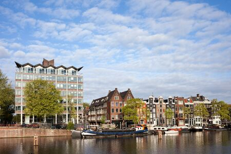 amstel: Amsterdam city skyline from the Amstel River in Holland, Netherlands Stock Photo