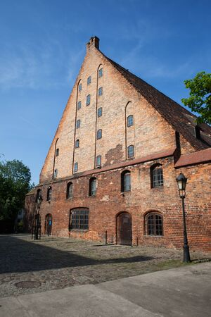 historical landmark: Great Mill (Wielki M?yn) in Gdansk, Poland, Europe, built by the Teutonic Knights in 1350, historical city landmark, medieval brick structure