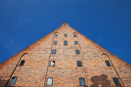 historical landmark: Great Mill (Wielki M?yn) in Gdansk, Poland, Europe, built by the Teutonic Knights in 1350, historical city landmark, pyramid, triangle shape, medieval brick structure