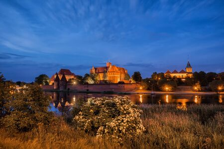 teutonic: Malbork Castle at night in Poland, Teutonic Knights medieval fortress, UNESCO World Heritage Site