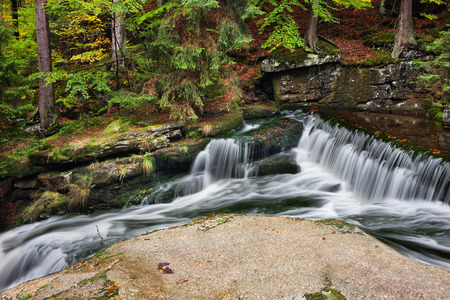 sudetes: Stream with water cascade in picturesque scenery of autumn mountain forest