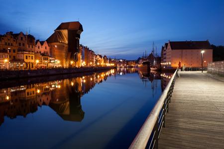 gdansk: City of Gdansk in Poland by night, Old Town skyline, boardwalk promenade along Motlawa River Stock Photo