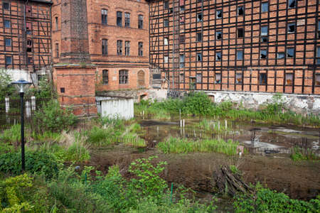 abandoned: Rother Mills and pond on Mill Island, abandoned industrial building in city of Bydgoszcz, Poland