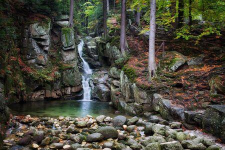 krkonose: Waterfall in autumn forest of Karkonosze Mountains, Przesieka, Poland