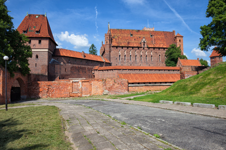 side order: Malbork Castle in Poland, medieval fortress built by the Teutonic Knights Order, High Castle side, historic landmark dating back to 13th century.