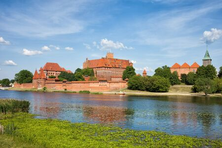 teutonic: Malbork Castle and Nogat River in Poland, medieval landmark fortress of the Teutonic Knights Order Editorial