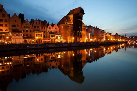 waterfront: City skyline of Gdansk at evening in Poland, Old Town with reflection on Motlawa River