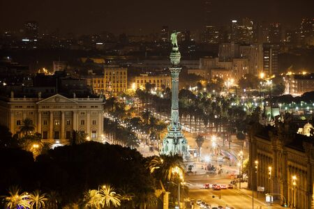 Spain, Barcelona, city by night, Columbus Monument, Passeig de Colom avenue, downtown cityscape