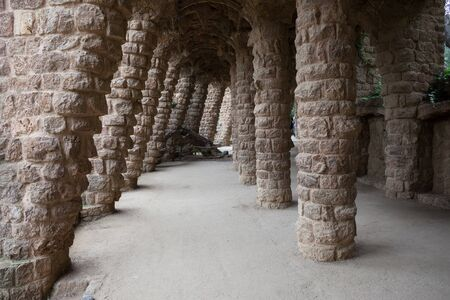 colonnaded: Spain, Barcelona, Park Guell, colonnaded passage with angled columns of Passeig de les Palmeres (public part outside of monumental zone) Editorial