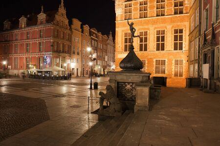 gabled house: Old Town of Gdansk by night in Poland, historic city centre, Long Market Street Stock Photo
