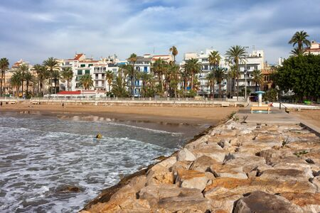 Spain, Catalonia, Sitges, coastal town at Mediterranean Sea, beach and skyline from a pier Stock Photo