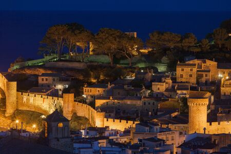 spanish home: Old Town of Tossa de Mar illuminated at night at Costa Brava in Catalonia, Spain Stock Photo