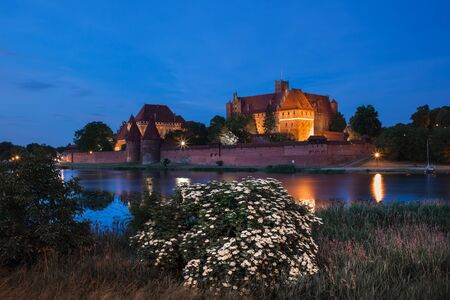 fortify: Malbork Castle at night in Poland, Teutonic Knights Order medieval fortress at the Nogat River