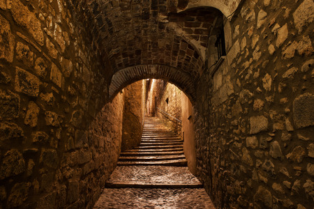 City of Girona in Catalonia, Spain, Sant Llorenc street at night, medieval passage with stairs in Old Quarter - Barri Vell Stock Photo
