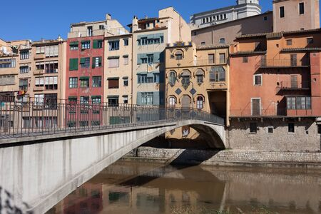 gomez: Historic houses and Gomez Bridge in Old Quarter of Girona in Catalonia, Spain Stock Photo