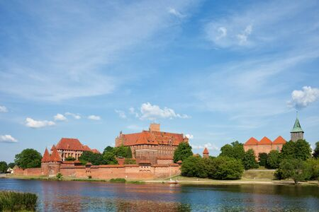 13th century: Malbork Castle in Poland, 13th century medieval landmark at the Nogat River Stock Photo