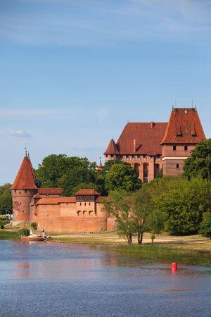 teutonic: Malbork Castle in Poland, medieval landmark at the Nogat River Stock Photo