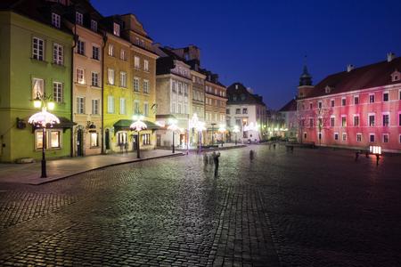 stare miasto: Old Town (Stare Miasto) in city of Warsaw by night in Poland, Castle Square (Plac Zamkowy), historic tenement houses