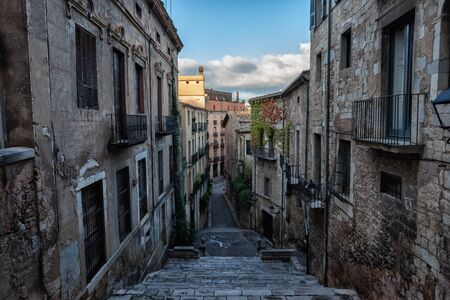 Old Town (Barri Vell) historic architecture in city of Girona in Catalonia, Spain, buildings along Sant Domenec stairs