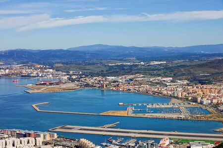 Gibraltar Bay with airport runway, La Linea de la Concepcion town and port in Spain Stock Photo
