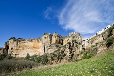 Andalucia landscape with El Tajo Gorge rocks and meadow on a hill slope in Ronda, Spain Stock Photo