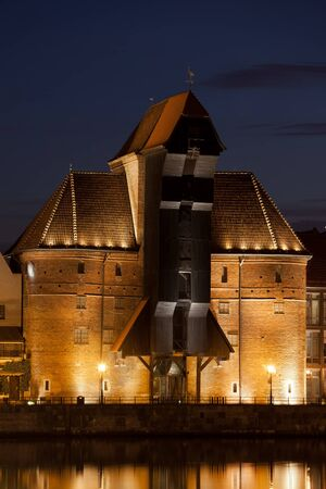 lift gate: The Crane (Zuraw) illuminated at night in Gdansk, Poland, Europe, medieval landmark and symbol of the city