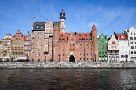 Poland, city of Gdansk, Old Town skyline with Chlebnicka Gate in the middle and gabled merchant houses, view from Motlawa River
