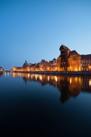 water town: City of Gdansk Old Town skyline at twilight in Poland, water reflection on Old Motlawa river