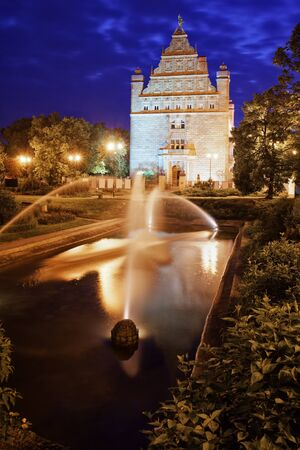 Park with fountain by night in Torun city, Poland, Collegium Maximum Museum of Nicolaus Copernicus University