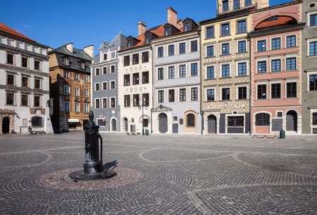 water town: City of Warsaw in Poland, Old Town Market Square (Polish: Rynek Starego Miasta), historic houses and water pump on cobbled plaza