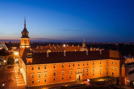 Poland, Warsaw, Old Town, Royal Castle illuminated at night, historic city landmark