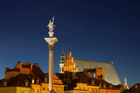 Warsaw Old Town skyline at night, Sigismunds Column with statue of King Sigismund III Vasa