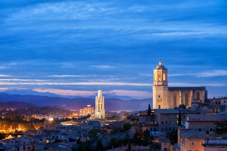 City of Girona twilight cityscape in Catalonia, Spain, Old Town with Cathedral of Saint Mary and Basilica of Sant Feliu