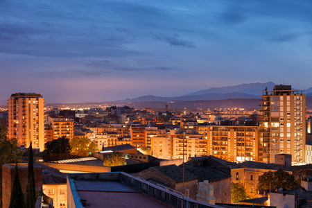 Girona city twilight cityscape, apartment buildings, houses, block of flats, residential district in Gerona, Catalonia, Spain