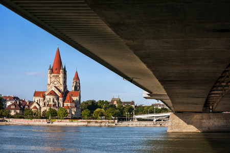 Austria, city of Vienna, under the Imperial Bridge (Reichsbrucke) view of St. Francis of Assisi Church at Danube River