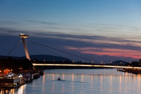 Slovakia, Bratislava, Most SNP - New Bridge or UFO Bridge on Danube River at twilight, city landmark Stock Photo