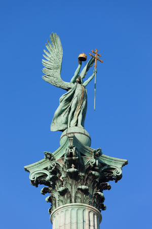 Archangel Gabriel statue holding Holy Crown of St. Stephen and Apostolic Cross, part of the Millennium Monument on the Heroes Square in Budapest, Hungary
