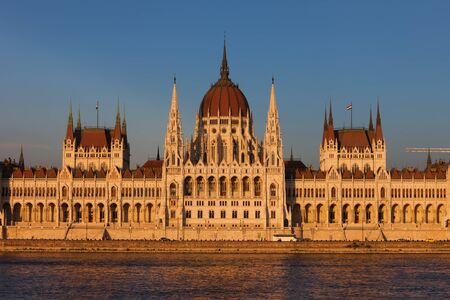 gothic revival: Hungary, Budapest, Hungarian Parliament at sunset by the Danube river, city landmark, Gothic Revival style building Stock Photo