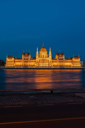 Hungarian Parliament at night in Budapest, Hungary, city landmark at the Danube river